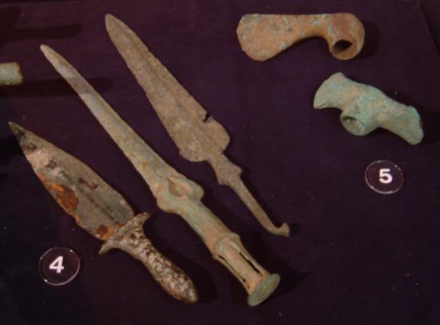 Mesopotamian_bronze_daggers,_axe_head_and_mattock_REM.JPG