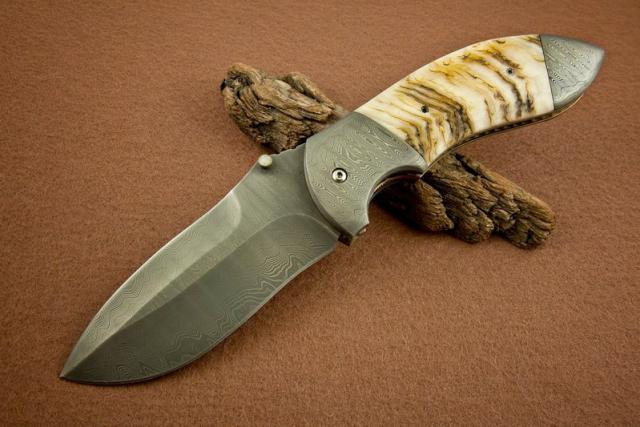 01-1-1_Damascus Blade & Bolsters w Magnificent Sheep horn scales.jpg