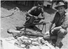 New Britain coast-watcher Lieutenant Joe Sampson and a native troop member